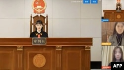 "A virtual judge hears litigants in a case before a Chinese ""internet court"" in Hangzhou, China. (Courtesy: AFP/YouTube video)"