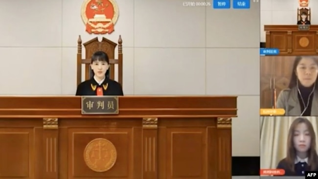 """A virtual judge hears litigants in a case before a Chinese """"internet court"""" in Hangzhou, China. (Courtesy: AFP/YouTube video)"""
