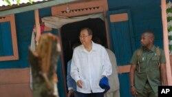 U.N. Secretary-General Ban Ki-moon walks out after visiting the house of a cholera victim during the launching of sanitation campaign in Hinche, Haiti, July 14, 2014.