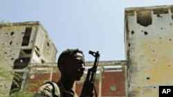 A Somali government soldier patrols the streets of capital Mogadishu, February 22, 2012
