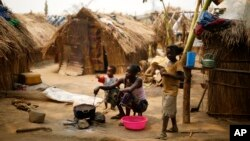 FILE - Families living in a refugee camp prepare food in Kaga-Bandoro, Central African Republic, Feb. 16, 2016. Nearly half of the country's population of 4.6 million is in need of humanitarian assistance.