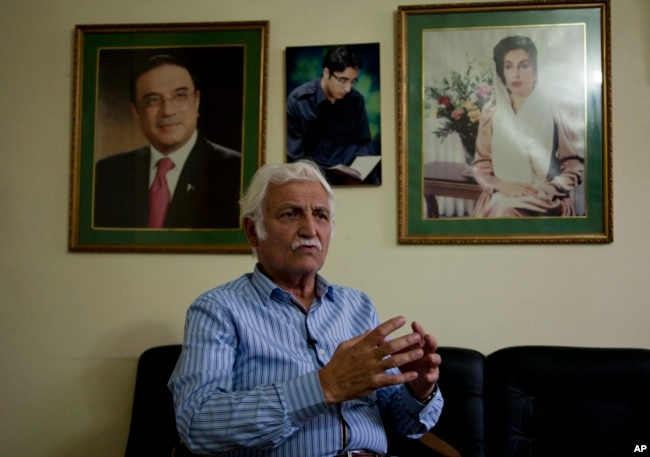 FILE - Pakistani Senator Farhatullah Babar talks to the Associated Press in Islamabad, Pakistan, Oct. 27, 2016.