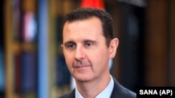 "FILE - Syrian President Bashar Assad, shown in a September 2015 photo, has ""lost the credibility to be able to unite the country,"" said U.S. Secretary of State John Kerry."