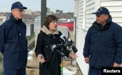 U.S. Sen. Susan Collins, R-Maine, addresses reporters after a ribbon-cutting at a U.S. Coast Guard regional command center, Feb. 20, 2019, in South Portland, Maine. Collins said that she would vote for a congressional resolution disapproving of President Donald Trump's emergency declaration to build a wall on the southern border.