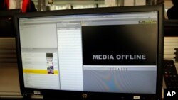FILE - The screen of a hacked computer is seen in an office.