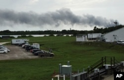 Smoke rises from a SpaceX launch site, Sept. 1, 2016, at Cape Canaveral, Fla. NASA said SpaceX was conducting a test firing of its unmanned rocket when a blast occurred.
