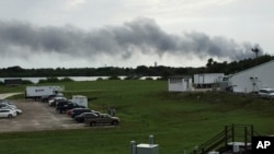 FILE - Smoke rises from a SpaceX launch site at Cape Canaveral, Fla, Sept. 1, 2016. SpaceX was conducting a test firing of its unmanned rocket when a blast and fire occurred.