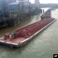 This is one of four massive barges that broke away from their towboat on the Ohio River last April. One sank.