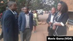 FILE: Zimbabwean journalists gather outside magistrates court in Harare.