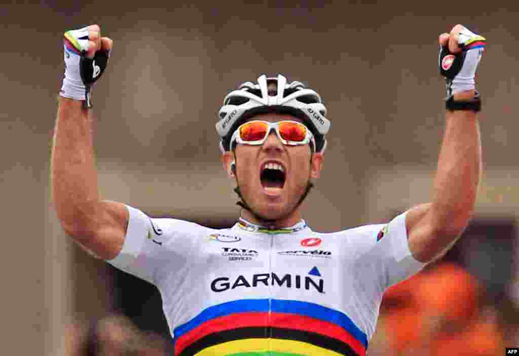 July 14: Thor Hushovd of Norway crosses the finish line to win the 13th stage of the Tour de France cycling race. (AP Photo/Laurent Rebours)