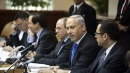 Israel's Prime Minister Benjamin Netanyahu (2nd R) attends the weekly cabinet meeting in Jerusalem, January 13, 2013.