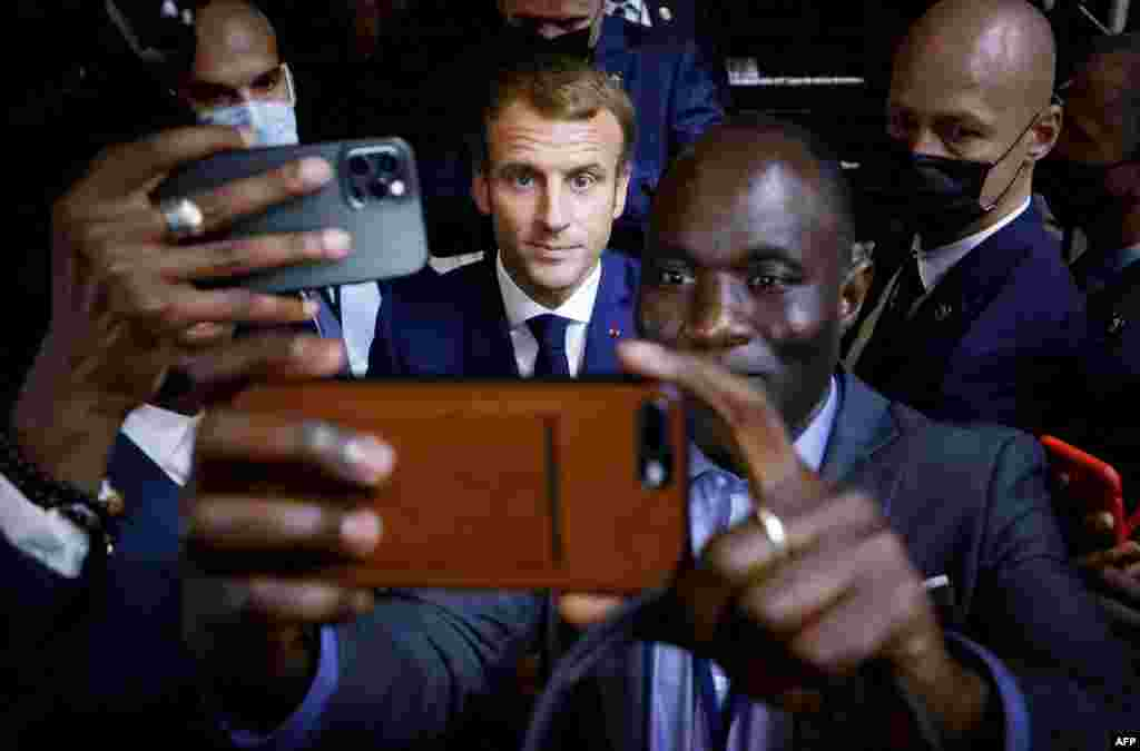 French President Emmanuel Macron, center, poses for a selfie after a basketball game during an Africa-France 2021 Summit in Montpellier, southern France.