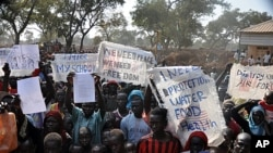 Refugees protest at Yida camp in South Sudan at the lack of UN military intervention and humanitarian assistance to provide food, water, schooling and health services, November 17, 2011.