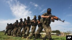 Masked militants from Islamic Jihad are seen during a training exercise, (File photo).