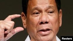 FILE - Philippine President Rodrigo Duterte delivers a speech at Philippines Economic Forum in Tokyo, Japan, Oct. 26, 2016.