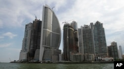 FILE - Тhe Trump Ocean Club International Hotel and Tower, third building from left, are seen in Panama City, Panama, July 4, 2011. An attempt to oust President Donald Trump's hotel business from managing a Panama luxury hotel has turned bitter, with accusations of financial misconduct.