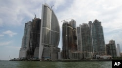 FILE - Тhe Trump Ocean Club International Hotel and Tower, third building from left, are seen in Panama City, Panama, July 4, 2011.