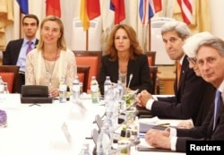 European Union foreign policy chief Federica Mogherini, left, U.S. Secretary of State John Kerry, third from left, Under Secretary for Political Affairs Wendy Sherman and British Foreign Secretary Philip Hammond, right, wait for the start of a meeting in
