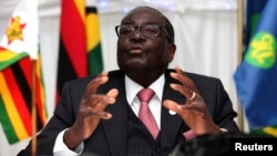 FILE: Zimbabwe President Robert Mugabe speaks at the 34th Southern African Development Conference (SADC) summit in Victoria Falls, August 18, 2014.