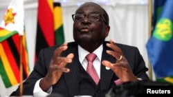 The United States imposed sanctions on Zimbabwe President Robert Mugabe and his inner circle saying they violated human rights and failed to hold free and fair elections in the country.