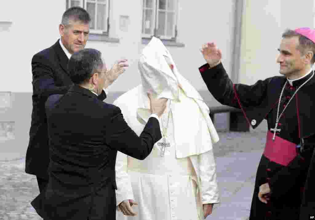 A gust of wind blows Pope Francis' mantle as he arrives for a meeting with people assisted by the church, at the Cathedral of Saints Peter and Paul in Tallinn, Estonia.