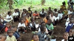 Refugee children from the Democratic Republic of Congo attend class in a forest near Gangania, more than 850 km north of Brazzaville, the capital of neighboring Congo. Most of the teachers are also refugees who fled inter-ethnic violence in the northweste