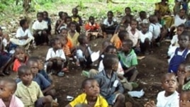 Refugee children from the Democratic Republic of Congo attend class in a forest near the town of Gangania, more than 850 km north of Brazzaville, the capital of neighboring Congo, 25 Feb 2010