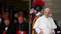 Pope Francis leaves a morning session of the Synod of bishops, at the Vatican, Oct. 5, 2015. He urged the contentious gathering of the world's bishops on family issues to put aside personal prejudices and have the courage and humility to be guided by God.