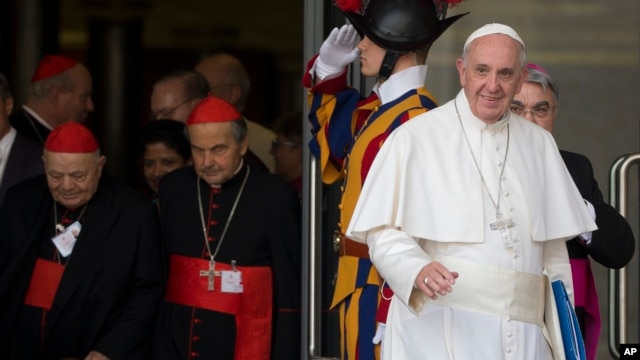 FILE - Pope Francis leaves a morning session of the Synod of bishops, at the Vatican, Oct. 5, 2015.