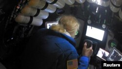 Undersea explorer Victor Vescovo pilots the submarine DSV Limiting Factor in the Pacific Ocean's Mariana Trench in an undated still image from video released by the Discovery Channel, May 13, 2019.
