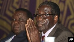 Zimbabwean Prime Minister Morgan Tsvangirai, left, and President Robert Mugabe, Harare, November 2011.