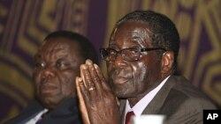 Zimbabwean Prime Minister Morgan Tsvangirai, left, and President Robert Mugabe, Harare, November 11, 2011.