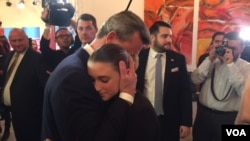 Far-right candidate Norbert Hofer hugs daughter following his election defeat, in Vienna, Austria, Dec. 4, 2016 (L. Ramirez/VOA). Hofer has vowed to continue his fight.