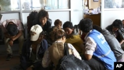 Tibetans, who were arrested in Bajura district in far-western Nepal for crossing the Nepal-Tibet border to arrive in Kathmandu, await their interrogation at Nepal's Immigration office in Kathmandu September 14, 2011. Twenty Tibetans have been arrested whi