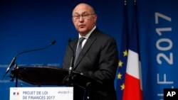 France's Finance and Economy Minister Michel Sapin delivers a speech during a press conference in Paris, Wednesday, Sept. 28, 2016.