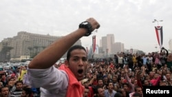 University students and supporters of the Muslim Brotherhood occupy Tahrir Square in Cairo, Dec. 1, 2013.