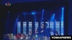 김정은 국방위원회 제1위원장이 관람한 공연에서 주제곡과 함께 상영된 미국 영화 `록키'의 한 장면(조성중앙TV 화면).