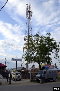 After unidentified militants threatened to attack mobile phone towers and kill the people who are involved in mobile service-related businesses in Kashmir, police have provided security to the towers in Baramulla district, June 3, 2015. (Tajamul Lone for