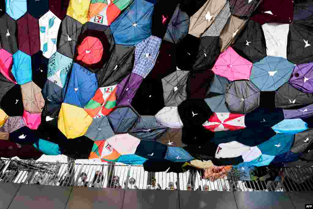 Pro-democracy protesters set up a colorful canopy of broken umbrellas near the central government complex in Hong Kong.