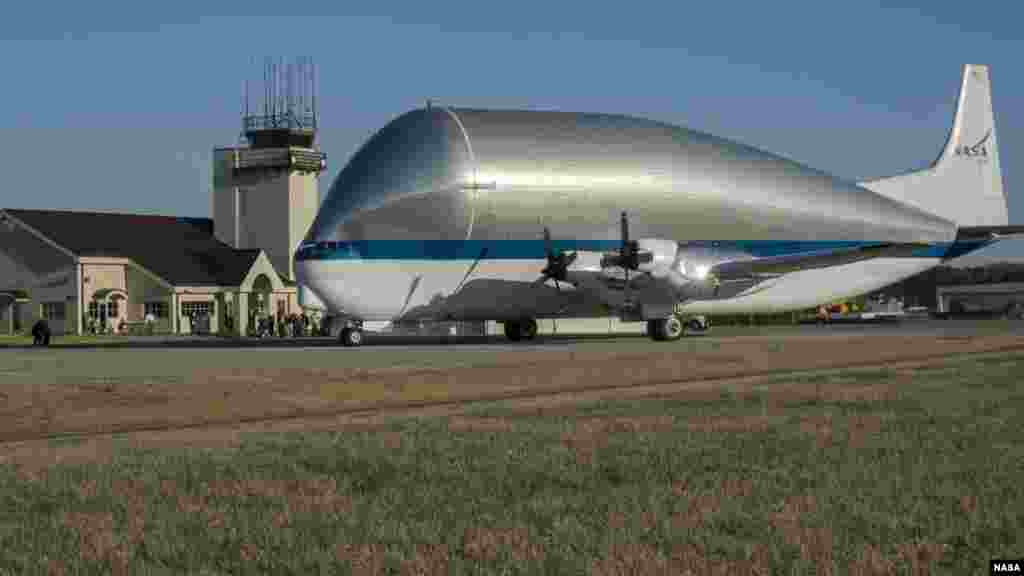 NASA's Super Guppy, a wide-bodied cargo aircraft, landed at the Redstone Army Airfield near Huntsville, Alabama with a special delivery: an innovative composite rocket fuel tank, Mar. 26, 2014.