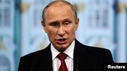 俄羅斯總統普京5月23日在聖彼得堡國際經濟論壇發表演講