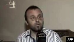 A picture grab taken on August 27, 2012 from the Syrian Al-Ikhbariya news channel shows Turkish journalist Cuneyt Unal, who has been missing in Syria for a week and reportedly being held by troops loyal to President Bashar al-Assad.