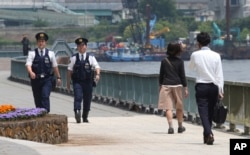 Police officers patrol along the Sumida River in Tokyo, May 23. 2016. Japanese cities have beefed up the security as the country hosts Group of Seven Summit in the Ise-Shima region, central Japan, on May 26 and 27.