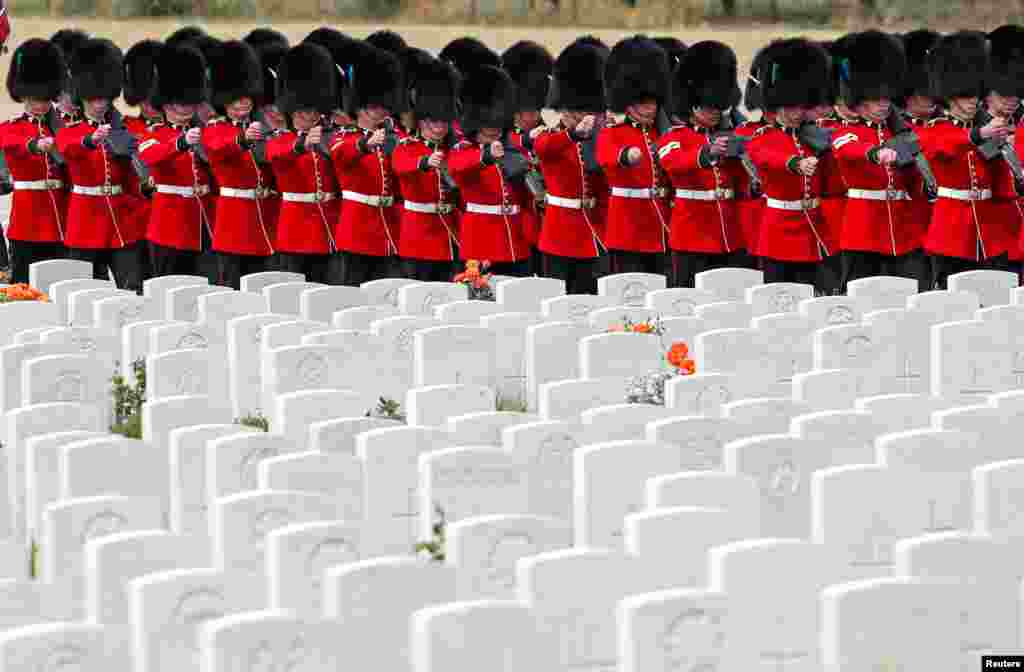Irish Guards march at the Tyne Cot cemetery ahead of a commemoration to mark the centenary of Passchendaele, The Third Battle of Ypres, in Zonnebeke, Belgium.