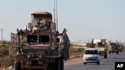 Arxiv fotosu - ABŞ hərbi qüvvələri Mənbicdə, 31 mart, 2018.