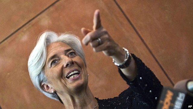 French Finance Minister Christine Lagarde gestures during a press conference at the French Embassy in Beijing, June 9, 2011.