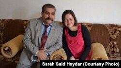 FILE - Sarah Said Haydar, 16, with her father before her capture by Islamic State militants last August.
