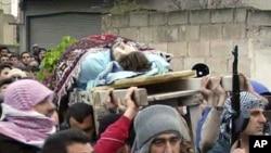 시리아 홈즈 시 장례식 (7일 공개된 아마추어 비디오 캡처 사진)