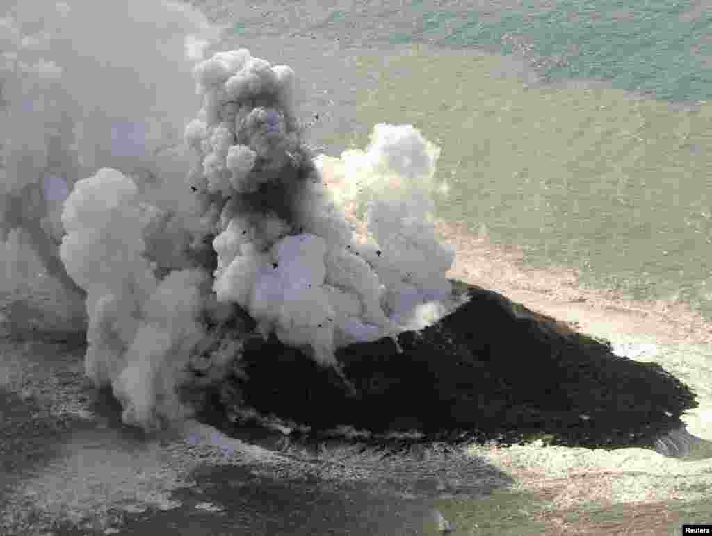 Smoke from an erupting undersea volcano forms a new island off the coast of Nishinoshima, a small uninhabited island, in the southern Ogasawara chain of islands, Japan, in this picture provided by Kyodo.