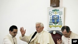 Pope Benedict XVI speaks to Catholic faithful at Notre Dame cathedral in Cotonou, Benin, Nov. 18, 2011.